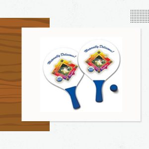 """( LARGE SIZE PB – 200 ) 9-1/4"""" W X 15"""" L ( SMALL SIZE PB – 201 ) 7-1/2"""" W X 13"""" L BALL SIZE: 1-1/2"""" DIAMETER Pricing Includes; 2 Paddles with a Full Color Imprint and / or Bleed on One Side, Color Coordinated Handles and Ball with a Re-closable Plastic Net Bag. ( Custom Canvas Drawstring Bags w/ a 1 color Imprint are Available for an Extra Charge: 250 Minimum Quantity. ) Material: Wood w/ Thick Foam Handles and Rubber Ball Starts off White Sizing: 15"""" or 13"""" Packaging: Mesh Bag Full Color Set-up Charge: $75.00 per Side Ball Size: 1-1/2"""" Weight: 34 Lbs. / 25 Sets Artwork Format: Vector in EPS, Ai or PDF Custom Artwork Design: $100.00 upon Request Production: 10 Working Days Rush Available: Please Inquire"""